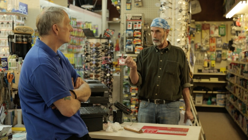 Stewart Dawson ranting to Pat Palmer at Nelson's Hardware